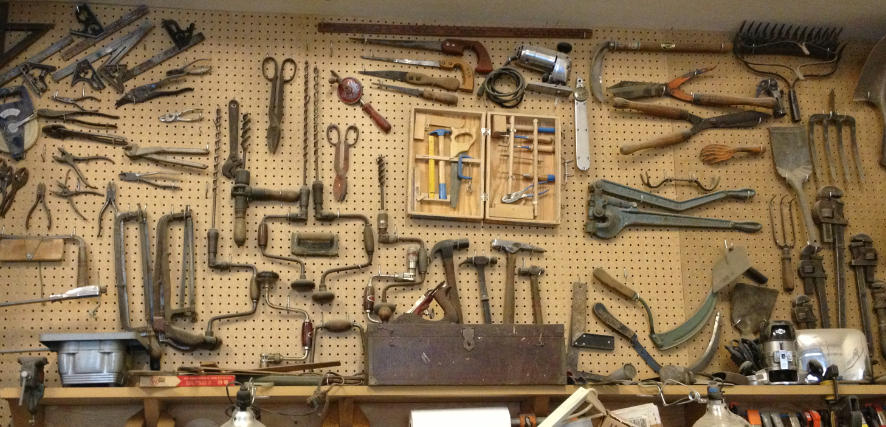 tools on a pegboard wall
